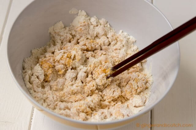 Mixing flour and eggs for homemade Chinese egg noodles